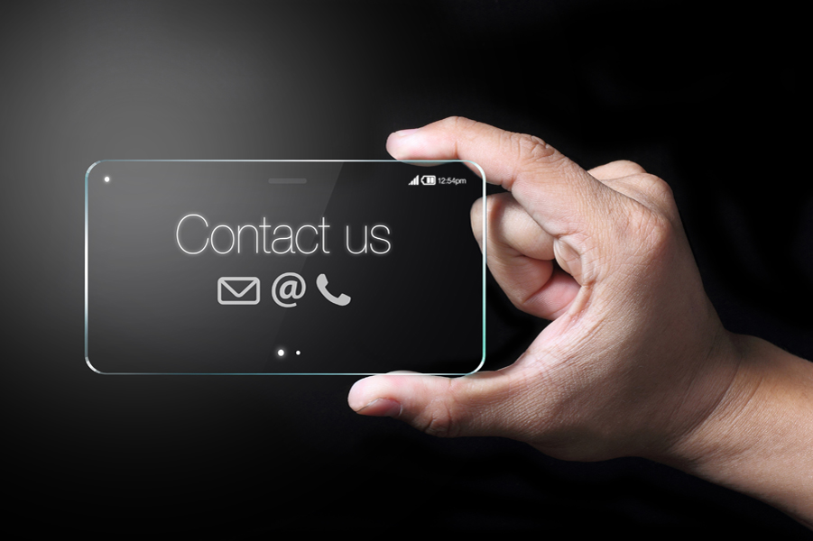 Transparent smartphone with contact us icons on black background.